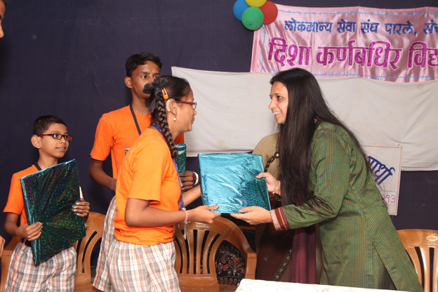 DISTRIBUTING PRIZE AT DEAF SCHOOL AS CHIEF GUEST ON OCCASION OF WDD