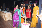 LIGHTLING A LAMP AS CHIEF GUEST AT SNDT UNIVERSITY