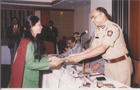 RECEIVING AWARD FOR COMMUNITY BETTERMENT GROM JOINT POLICE COMMISIONER
